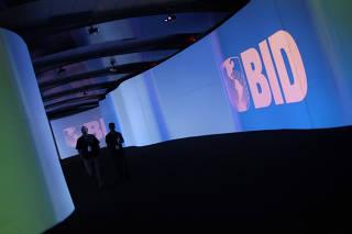 FILE PHOTO: Visitors walk past a screen with the logo of Banco Interamericano de Desarrollo at the Atlapa Convention Center in Panama City