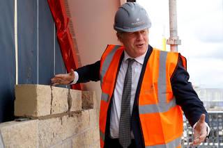 FILE PHOTO: Britan's PM Boris Johnson visists a construction site in Cheshire