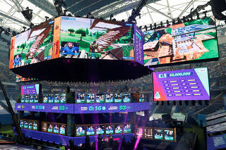 FILE PHOTO: Contestants compete during the Fortnite World Cup Duos Finals at Flushing Meadows Arthur Ashe stadium in the Queens borough of New York