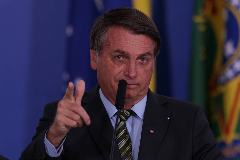"O presidente Jair Bolsonaro, durante a cerimônia ""Vencendo o Covid-19"", no Palácio do Planalto"