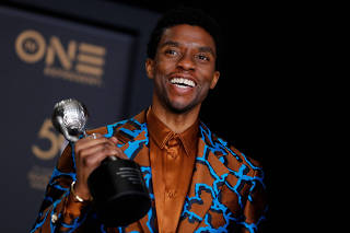 FILE PHOTO: 50th NAACP Image Awards ? Photo Room? Los Angeles - Chadwick Boseman poses backstage with his Outstanding Actor in a Motion Picture award for Black Panther