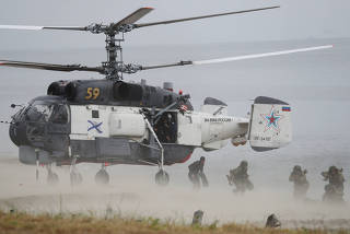 Russian marines disembark from a helicopter during the Ocean Shield 2020 naval exercise in Kaliningrad Region