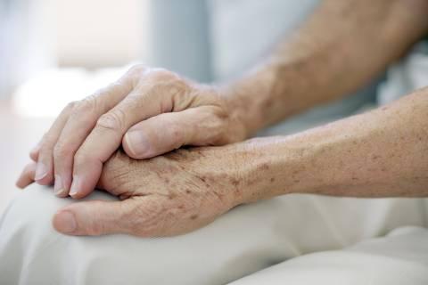 MODEL RELEASED. Senior couple holding hands.