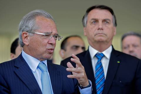 Brazilian Economy Minister Paulo Guedes (L) speaks next to Brazilian President Jair Bolsonaro (R) during a statement on financial aid for vulnerable Brazilians amid the COVID-19 pandemic, at Planalto Palace, in Brasilia, September 1 2020. - Brazil announced a reduction of 9.1% in the gross domestic product. (Photo by Sergio Lima / AFP) ORG XMIT: SLI
