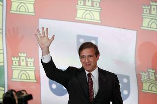 Portugal's Prime Minister and Social Democratic party leader Pedro Passos Coelho gestures to supporters after polls closed in a general election in Lisbon