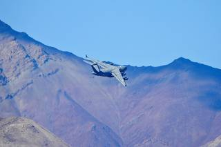 An Indian Air Force's (IAF) C-17 Globemaster transport plane flies over a mountain range in Leh