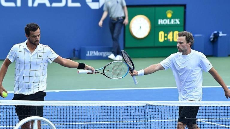Bruno Soares (à dir.) ao lado do croata Mate Pavic na semifinal do US Open