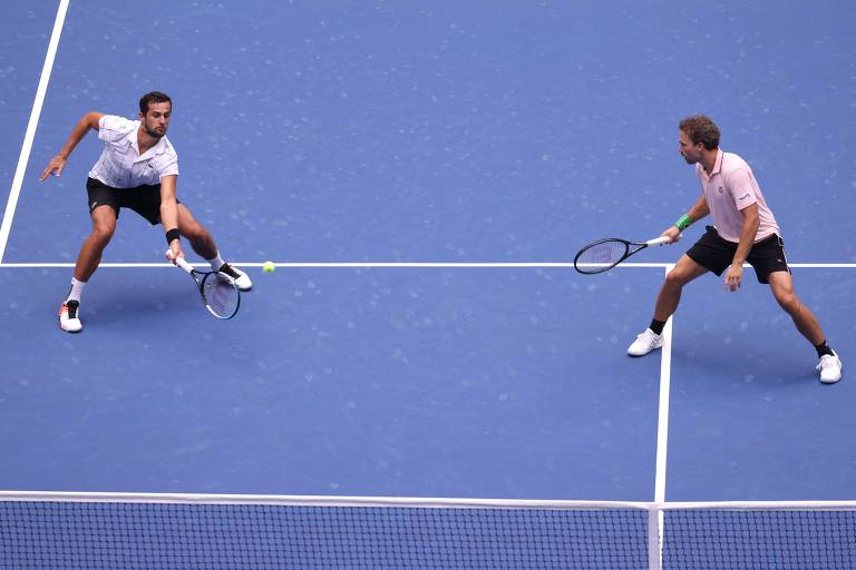 Bruno Soares (à dir.) e Mate Pavic em ação na final de duplas do US Open