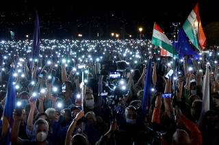 FILE PHOTO: People take part in a protest for media freedom in Budapest
