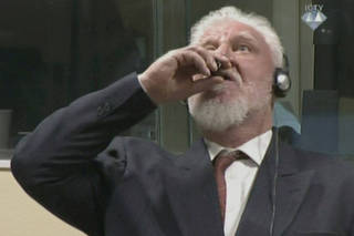 A wartime commander of Bosnian Croat forces, Slobodan Praljak, is seen during a hearing at the U.N. war crimes tribunal in the Hague