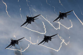Mikoyan Mig-29 jet fighters of the Strizhi (Swifts) aerobatic team perform during International military-technical forum
