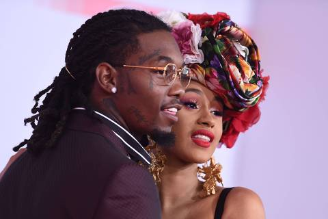 (FILES) In this file photo taken on October 9, 2018 US rapper Cardi B and US rapper Offset arrive at the 2018 American Music Awards in Los Angeles, California. - After three tumultuous years of marriage, superstar rapper Cardi B filed for divorce September 15 from her husband, rapper Offset, according to court records. The couple, who married secretly in September 2017, had already been through a well-publicized rough patch that resulted in her announcing their break-up almost two years ago. (Photo by Valerie MACON / AFP)