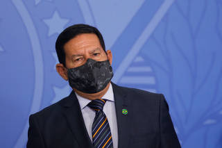 Brazil's Vice President Hamilton Mourao looks on during an inauguration ceremony of the new Health Minister in Brasilia