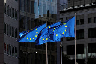 European Union flags flutter outside the European Commission headquarters in Brussels