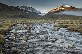 Kolotuk Creek flows out of the Romanzof Mountains in the Arctic National Wildlife Refuge in Alaska, June 15, 2019. (Christopher Miller/The New York Times)