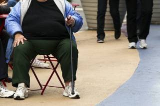 File of an overweight woman sits on a chair in Times Square in New York