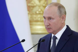 Russia's President Putin addresses members of the Federation Council in Moscow