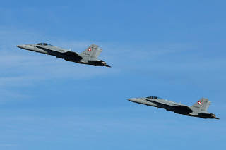 Two F/A-18 Hornet fighter jets of the Swiss Air Force take off in Payerne