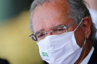 Brazil's Economy Minister Paulo Guedes looks on during a press statement at the Alvorada Palace in Brasilia