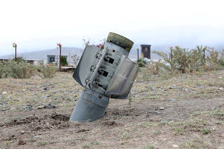 FILE PHOTO: The remains of a rocket shell are seen near a graveyard at the town of Ivanyan (Khojaly) in the breakaway region of Nagorno-Karabakh