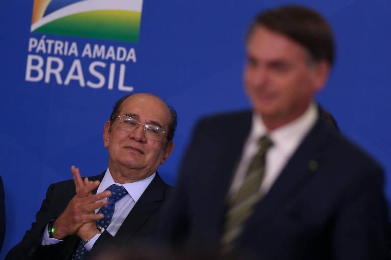 O presidente Jair Bolsonaro e o ministro do STF, Gilmar Mendes, em cerimônia de posse do  ministro da Justiça, André Mendonça, no Palácio do Planalto