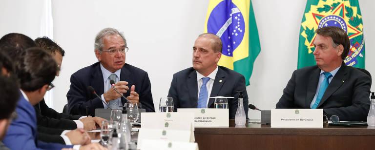 Ministro Paulo Guedes (Economia), ministro Onyx Lorenzoni (Cidadania) e o presidente Jair Bolsonaro