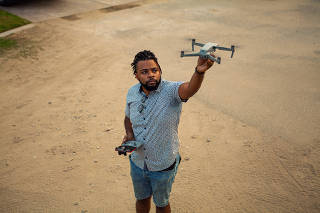 Steven Ray Littles II left his job as a Delta Air Lines flight attendant and plans to pursue a hobby in drone photography as a business. (Horatio Baltz/The New York Times)