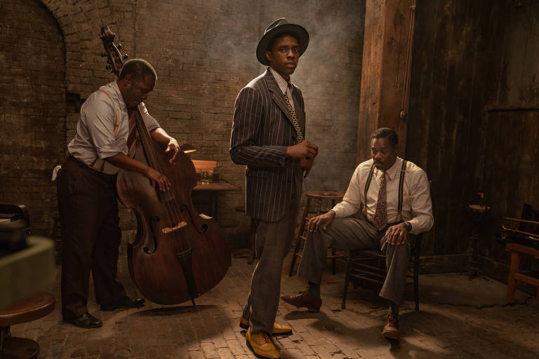 Black Bottom de Ma Rainey (2020): (da esquerda para a direita) Michael Potts como Slow Drag, Chadwick Boseman como Levee e Colman Domingo como Cutler