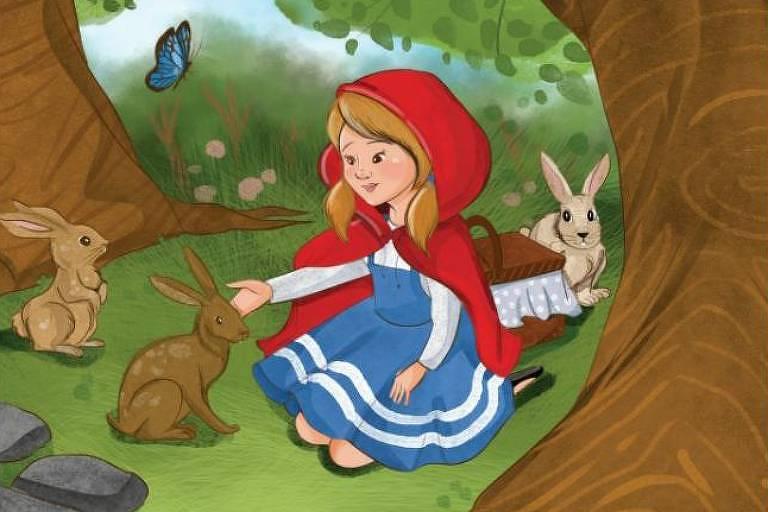 Menina com capa com gorrinho vermelho em bosque alimenta coelhos