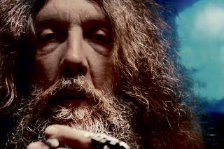 A photo of comic book writer Alan Moore.