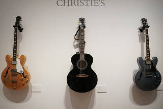 Guitars that will go up for sale as part of their Nashville Country auction are pictured at Christie's auction house, in New York