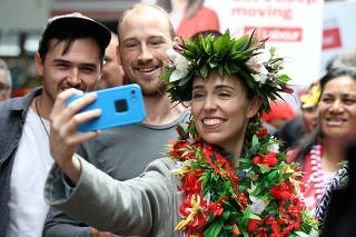 FILE PHOTO: New Zealand Prime Minister Ardern greets supporters in Auckland