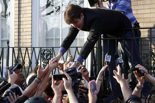 Former Governor of Illinois Blagojevich shakes hands with supporters after making a statement to reporters outside his Chicago home