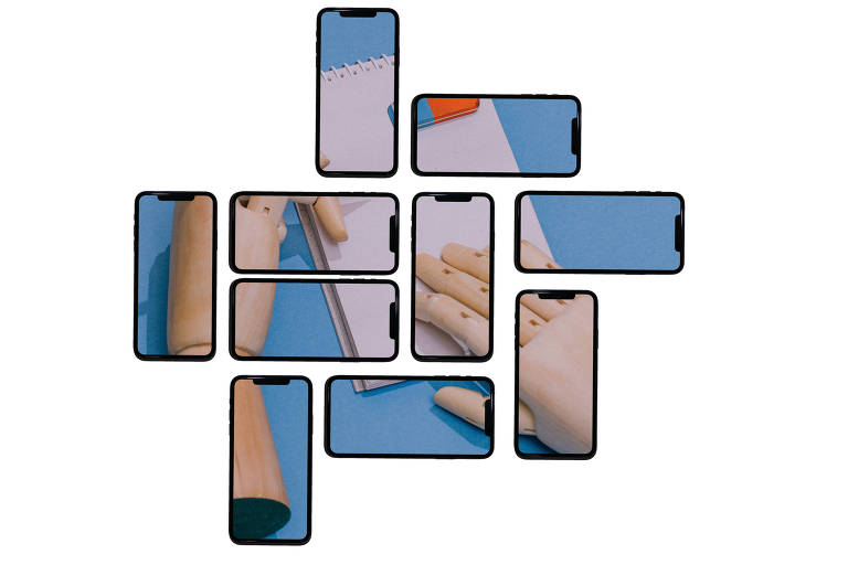 Vários celulares montam a imagem de uma mão de boneco com um bloco de notas e uma borracha