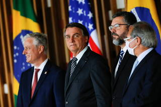 U.S. National Security Advisor O'Brien, Brazil's President Bolsonaro, Brazil's Foreign Minister Araujo and Brazil's Economy Minister Guedes look on as they prepare to address the media at the Itamaraty Palace in Brasilia