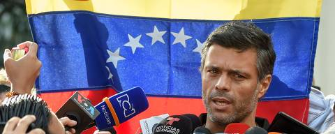 (FILES) In this file photo taken on May 02, 2019, Venezuelan high-profile opposition politician Leopoldo Lopez speaks outside the Spanish embassy in Caracas, where he sought refuge since claiming to have been freed from house arrest two days ago by rebel military personnel. - Leopoldo Lopez, a key Venezuelan opposition figure who has been holed up at the Spanish ambassador's residence in Caracas for the past 18 months, has left the embassy and fled the country, his father told AFP on October 24, 2020. (Photo by Juan BARRETO / AFP)