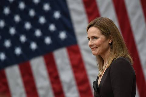 (FILES) In this file photo taken on September 26, 2020 Judge Amy Coney Barrett is nominated to the US Supreme Court by President Donald Trump in the Rose Garden of the White House in Washington, DC. - Barrett has been confirmed by the US Senate on October 26, 2020 to replace Justice Ruth Bader Ginsburg, who died on September 18. (Photo by Olivier DOULIERY / AFP)