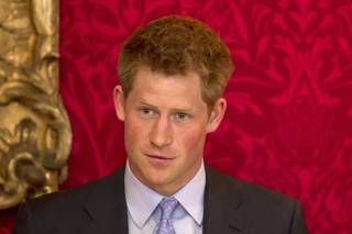 Britain's Prince Harry introduces the final lecture in a series by South African historian and lecturer Rob Caskie at St James's Palace in London