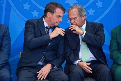 Jair Bolsonaro e Paulo Guedes em reportagem da Bloomberg sobre crise financeira