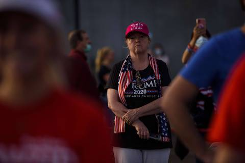 GASTONIA, NC - OCTOBER 21: Supporters of President Donald Trump gather for a rally 12 days before the election at Gastonia Municipal Airport on October 21, 2020 in Gastonia, North Carolina. Thousands of people joined to hear remarks from the president and other representatives in the heavily contested state.   Melissa Sue Gerrits/Getty Images/AFP == FOR NEWSPAPERS, INTERNET, TELCOS & TELEVISION USE ONLY ==