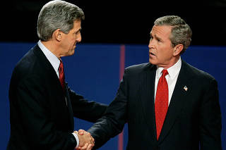 FILE PHOTO: President Bush shakes hands with John Kerry after presidential debate in Tempe.