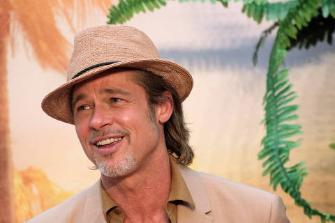 FILE PHOTO: Actor Brad Pitt smiles during the red carpet for