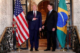 FILE PHOTO: U.S. President Donald Trump participates in a working dinner with Brazilian President Jair Bolsonaro at the Mar-a-Lago resort in Palm Beach, Florida