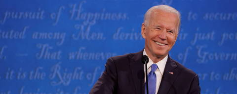 Democratic presidential nominee Joe Biden smiles during the final 2020 U.S. presidential campaign debate in the Curb Event Center at Belmont University in Nashville, Tennessee, U.S., October 22, 2020. REUTERS/Jonathan Ernst ORG XMIT: SINMEX