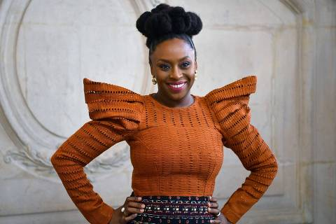 (FILES) In this file photo taken on January 20, 2020 Nigerian writer Chimamanda Ngozi Adichie poses during the photocall ahead of the Dior Women's Spring-Summer 2020/2021 Haute Couture collection fashion show in Paris. (Photo by Christophe ARCHAMBAULT / AFP)