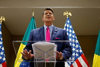 U.S Under Secretary of State for Economic Growth, Energy, and the Environment, Keith Krach speaks during a meeting with businessmen, economists and journalists
