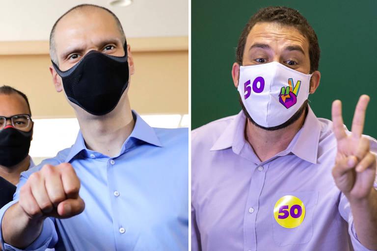 Os candidatos Bruno Covas e Guilherme Boulos após votarem em São Paulo neste domingo