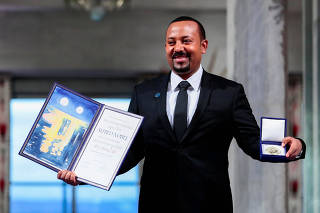 FILE PHOTO: Ethiopian Prime Minister Abiy Ahmed Ali poses with medal and diploma after receiving Nobel Peace Prize during ceremony in Oslo City Hall