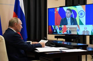 Russian President Putin attends the BRICS Summit via a video conference call outside Moscow