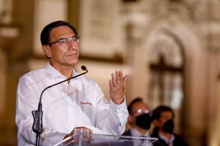Peru's President Martin Vizcarra addresses the media outside the presidential palace after lawmakers removed him on corruption charges, in Lima